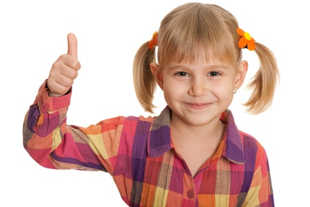 pretty little girl: A portrait of a pretty little girl holding her thumb up; isolated on the white background