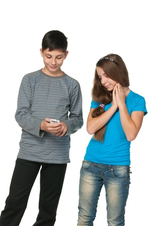 A portrait of fashion  teenagers with a cell phone; isolated on the white background photo