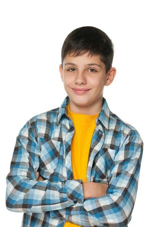 A portrait of a fashion smilingl teenager; isolated on the white background photo
