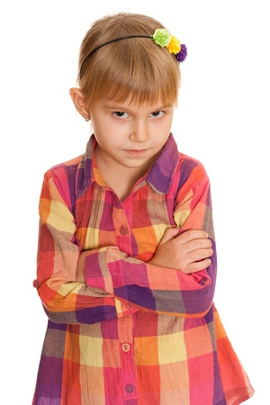 A portrait of a confident and serious  little girl ; isolated on the white background photo