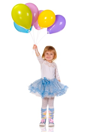 A cheerful little girl is playing with balloons; isolated on the white background Stock Photo
