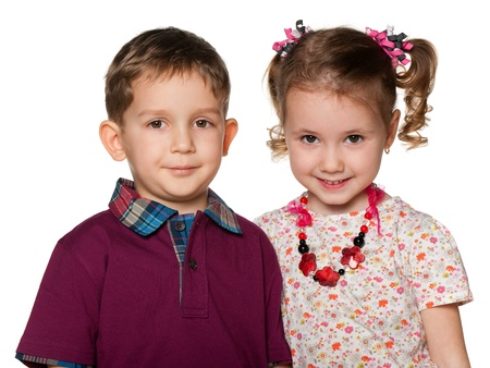 Two children are standing together; isolated on the white background photo