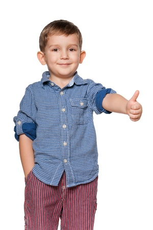 A portrait of a confident little boy holding his thumb up; isolated on the white background