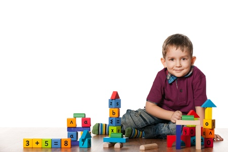 children playing with toys: A little boy is playing on the floor