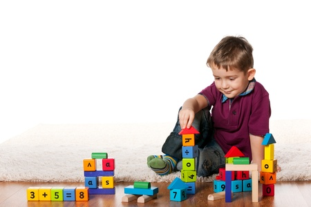 A handsome little boy is playing on the floor Standard-Bild