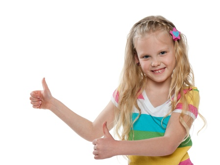 A portrait of pretty little girl holding her thumb up; isolated on the white background