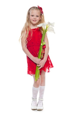A portrait of a pretty little girl with callas; isolated on the white background Standard-Bild