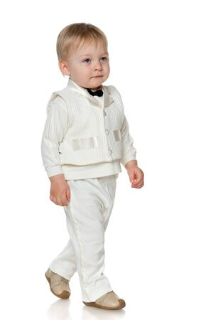A portrait of a walking toddler; isolated on the white background Stock Photo - 13024620
