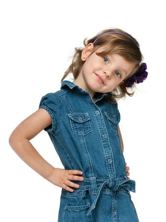 A portrait of a fashion smiling  little girl; isolated on the white background Standard-Bild