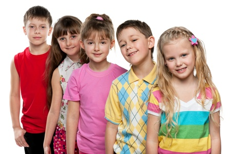 A little girl stands in front of a group of five children, focus is on the girl; isolated on the white background Stock Photo