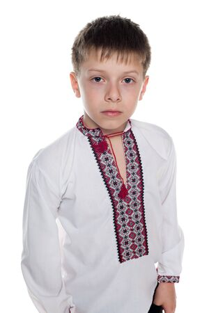 A portrait of a boy in Ukrainian national dress; isolated on the white background photo