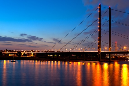 A night bridge over the Rein river in Dusseldorf GPS information is in the file Stock Photo