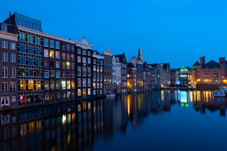 Wonderful view on  houses of Amsterdam in night  GPS information is in the file  photo