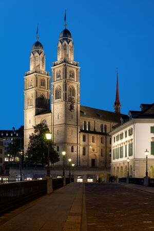 Night view on Grossmuenster in Zurich, Switzerland    photo