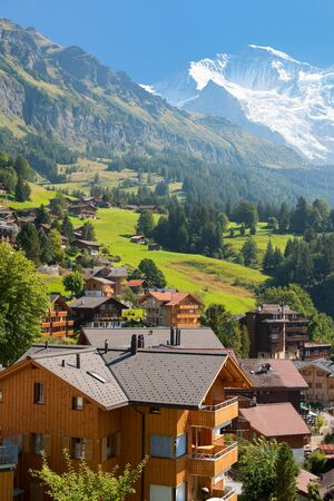 View on  Wengen and mountains from Wengen train station, Switzerland Stock Photo - 15815548