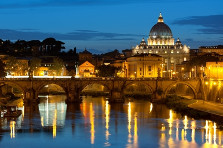 Classical view on Vatican over the Tiber river at night photo