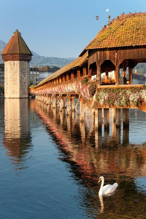 Wonderful morning view on Chapel Bridge and Water Tower in Luzern, Switzerland  photo