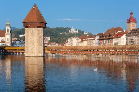 Morning view on Chapel Bridge and Water Tower in Luzern, Switzerland  Stock Photo - 15816911