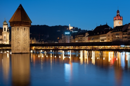lucerne: Luzern, Switzerland - September 8, 2012: Chapel Bridge in Luzern at night. Constructed in 14th centure, the Chapel Bridge was restored in 2002 after the fire which broke out at the night of August 17, 1993.