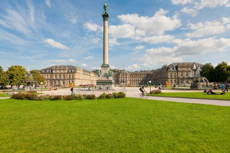 Stuttgart, Germany - September 17, 2012: Citizens and guests of the city are walking and resting on the Schlossplatz  in Stuttgart, near the New Castle, which was built between 1746 and 1807. GPS information is in the file.