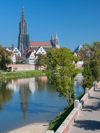 waterside: View on buildings of Ulm on the Danube riverbank in september