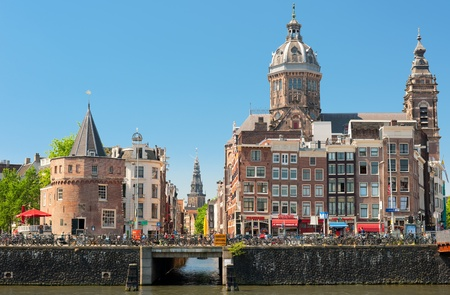 Amsterdam, Netherlands - May 28, 2012: Historic buildings in the center of Amsterdam. Having a population of more than 750,000  the country