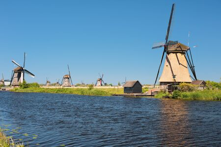 Windmills at Kinderdijk in a summer day; GPS information is in the file photo