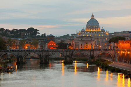 Classical view on Vatican over the Tiber river at early evening. photo