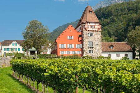 family owned: VADUZ, LIECHTENSTEIN - SEPTEMBER 11: Red house in the old district of Vaduz on September 11, 2012 in Vaduz. Since 1807 the Red House is owned by the Rheinberger family.