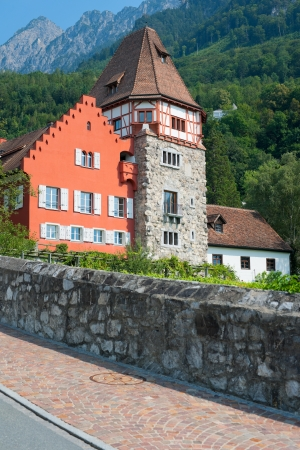 family owned: VADUZ, LIECHTENSTEIN - SEPTEMBER 11: Red house in the old district of Vaduz, Liechtenstein on September 11, 2012 in Vaduz. Since 1807 the Red House is owned by the Rheinberger family. Editorial