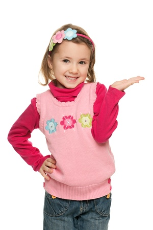 A portrait of a cheerful little girl in a pink blouse makes a hand gesture; isolated on the white background
