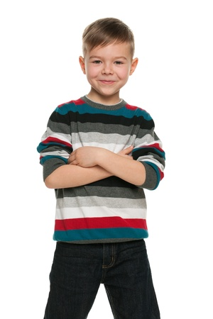 alone boy: A portrait of a smiling handsome little boy; isolated on the white background Stock Photo