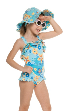 bathing   suit: A portrait of a smiling little girl in a swimsuit looking away; isolated on the white background