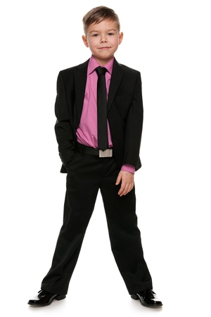 1 boy only: A portrait of a handsome boy in black suit; isolated on the white background Stock Photo