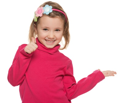 little finger: A portrait of a cheerful little girl in red with her thumb up; isolated on the white background