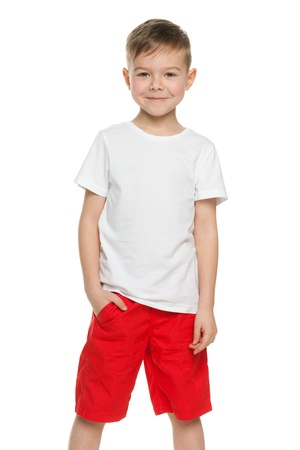 red shirt: A smiling little boy in white shirt; isolated on the white background Stock Photo