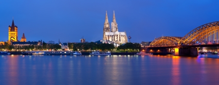 Panorama of night Cologne over the Rhein river photo