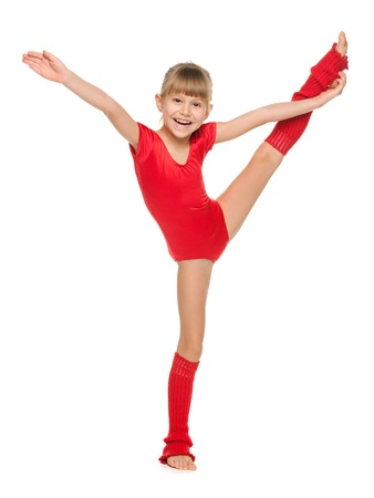 individual sport: A little cheerful gymnast shows an exercise Stock Photo