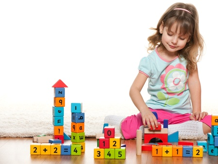 abc blocks: A pensive little girl is playing on the floor