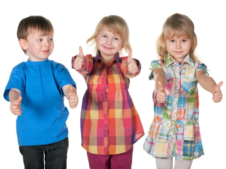 Three children are standing together on the white background photo