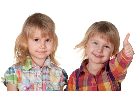 A portrait of two smiling pretty little girls on the white background photo