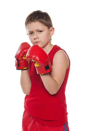 boy boxing: A portrait of a young boy in boxing gloves
