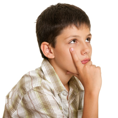 preteen boy: A closeup portrait of a concentrated boy on the white background