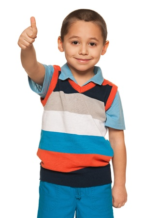 A smiling fashion little boy in striped shirt holding his thumb up on the white background
