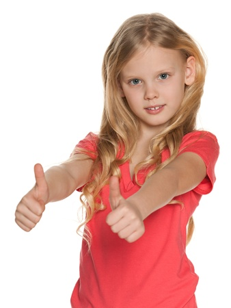 scandinavian people: A pretty scandinavian girl holds her thumbs up on the white background