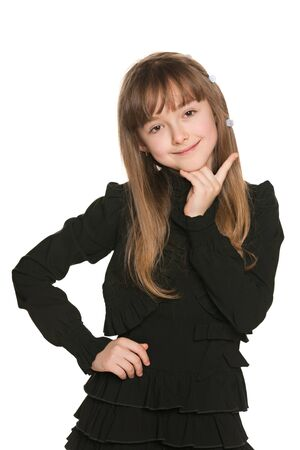 shy girl: Portrait of a shy girl in black makes a hands gesture Stock Photo