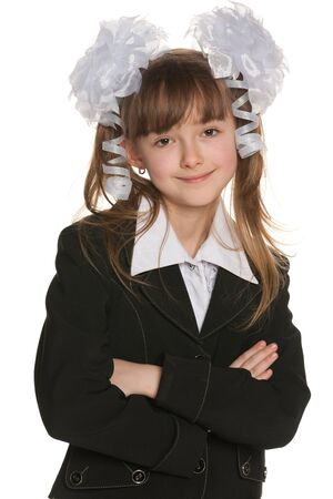 Portrait of a school girl in black on the white background photo