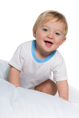 one little boy: A baby boy in the bed on the white background
