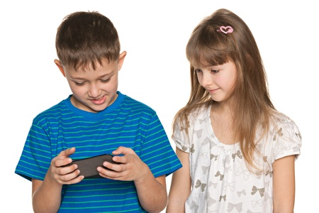 Two kids are playing with smartphone on the white background Stock Photo - 18664946