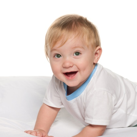 1 boy only: A laughing baby boy in the bed on the white background Stock Photo